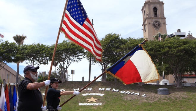 Richard Quijas (left) and Sue Heskett, members of the Veterans Band of Corpus Christi's color guard, present the colors during the Centennial Commemoration of WWI  at Spohn Park on Thursday, April 6, 2017.