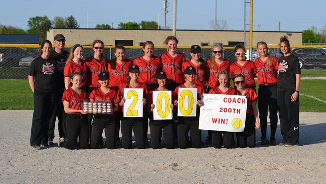 Frontier's softball team salutes coach Sharon Wright for her 200th victory Monday night.