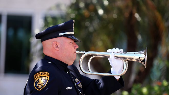 Corpus Christi Police Senior Officer Gary Williams performs Taps during the 11th annual Coastal Bend Peace Officers Memorial Day Ceremony at the Congressman Solomon P. Ortiz International Center on Monday, May 15, 2017.