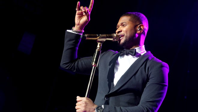 Usher, seen here late last year, is being hit by a lawsuit from three individuals who say he failed to tell them he had a sexually transmitted disease.