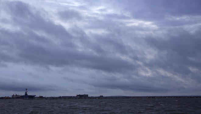 The sky darkens in the Corpus Christi Bay on Aug. 25 as Hurricane Harvey begins to bring rain and winds into Corpus Christi, Texas.