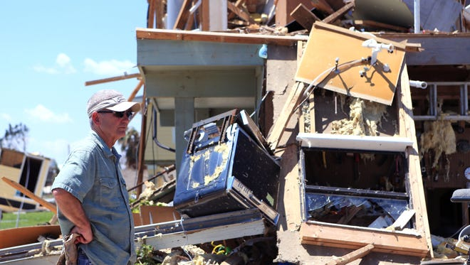 Kim Weatherford surveys the damage at his vacation home in Copano Cove in Rockport, Texas, on Wednesday, Aug. 30, 2017. (Rachel Denny Clow/Corpus Christi Caller-Times/TNS)