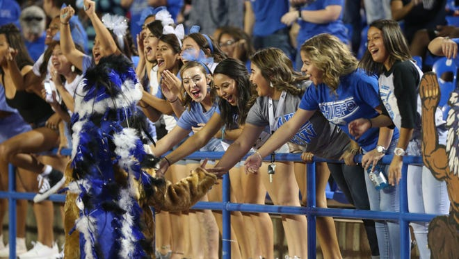 Fans get a high-five from the Lake View Chiefs mascot during a game last season against Andrews at San Angelo Stadium.