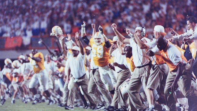 Tennessee's bench erupts after the Vols beat Florida in overtime, 20-17, on Sept. 19, 1998