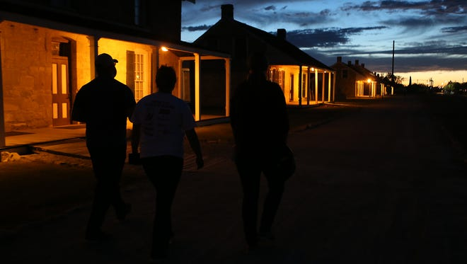 Clue-seekers search the grounds for clues during the second annual Murder at the Fort Concho mystery game Thursday, Oct. 19, 2017.