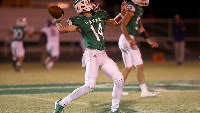 Wall quarterback Brock Rosenquist throws a pass against Crane on Oct. 20, 2017, at Hawk Stadium in Wall.