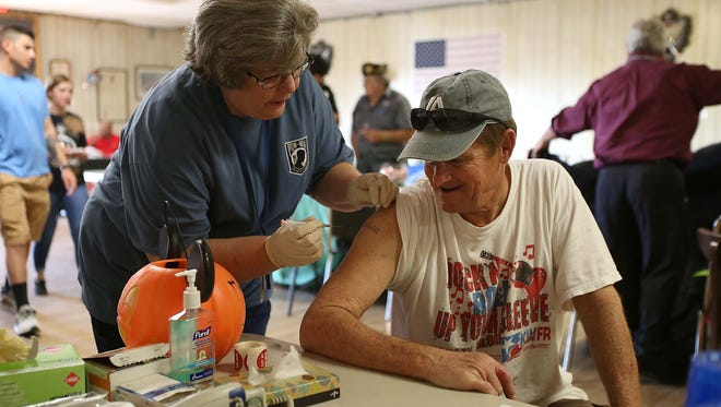 Veteran Gary Helms gets his free flu shot during the Veterans Benefit Fair and Homeless Veterans Stand-Down held attheVeterans of Foreign Wars Post 1815 Saturday, Nov. 4, 2017.