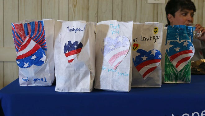 Children created snack packs for veterans during a fair at the Veterans of Foreign Wars Post 1815 Saturday, Nov. 4, 2017.