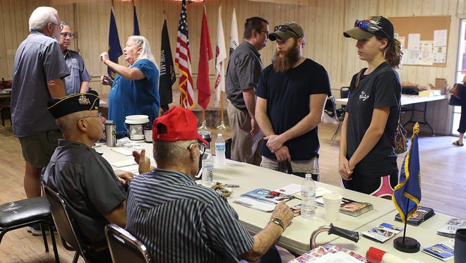Veterans chat with each other during the Veterans Benefit Fair and Homeless Veterans Stand-Down held attheVeterans of Foreign Wars Post 1815 Saturday, Nov. 4, 2017.