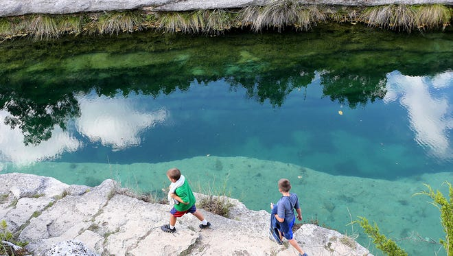 Sterling City elementary student walk along the Blue Hole, part of the Frio River, as they participate in the Sterling City Outdoor Education Program, a 2 1/2-day overnight education camp in Leakey, Texas, Tuesday, September 5, 2017.
