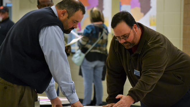 Henry Wilson, a Pickens County School Board trustee, at right, points out potential changes to attendance zones for elementary schools in Easley at a community meeting on Tuesday, Jan. 9.