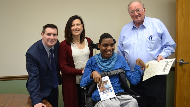 Richland County Commissioners Tony Vero, Marilyn John and Darrell Banks present a proclamation announcing Developmental Disabilities Awareness Month to Stephen, an individual who receives services from Richland Newhope.