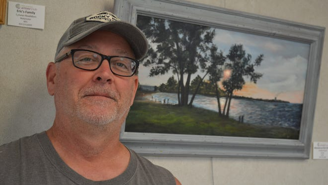 Keith Fleming, public relations representative and board member of the Greater Port Clinton Area Arts Council, maintains the Healing Wall at Magruder Hospital.