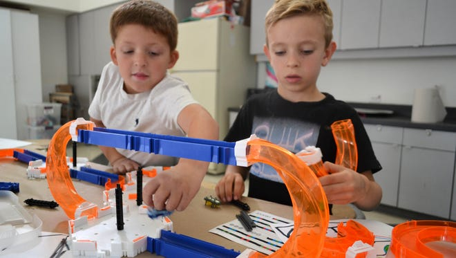 During the i.d.e.a. Museum's Multi-Generational Father's Day Tinkershop, families can take part in robotic activities together.