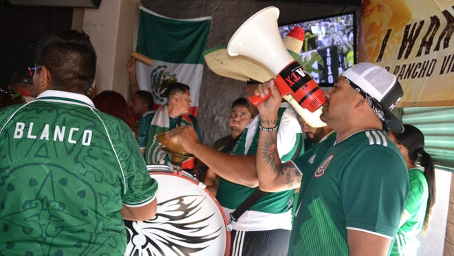 Members of the Phoenix chapter of Pancho Villa's Army root for Mexico in its World Cup match against Sweden on Wednesday, June 27, 2018 at Native Grill in Laveen, Ariz.