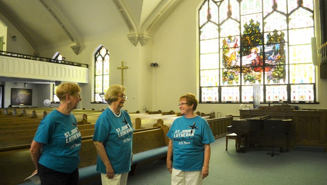 Bette Kaltenbach, Virginia Walther and Nancy Willis talk inside St. John's Lutheran Church, which has been a part of the Fremont community for 175 years.