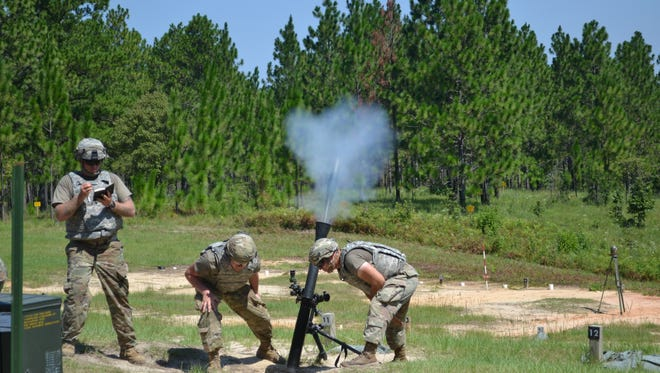 An 80 mm mortar shell can be seen as it exits the launch tube during a Louisiana National Guard mortar training exercise at XCTC training at Camp Shelby in Mississippi.