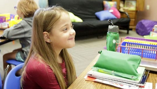 Natasha Fuller sits at her desk on the first day of school at Oakfield Elementary School. The second grader received a kidney from third grade teacher Jodi Schmidt over the summer.