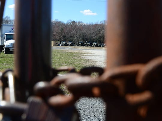A locked fence surrounding the Dewey Beach Police Department Federal Surplus storage located outside of the city limits on Monday, March 5, 2018.