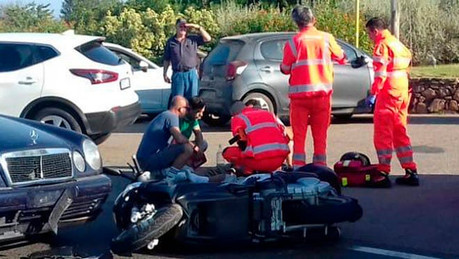 Ambulance personnel tend to a man lying on the ground, later identified as actor George Clooney, after being involved in a scooter accident in the near Olbia, on the Sardinia island, Italy, Tuesday, July 10, 2018.