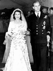 Princess Elizabeth, later Queen Elizabeth II, and Prince Philip leave Westminster Abbey after their wedding on Nov. 20, 1947.