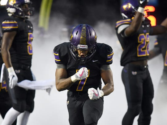 Hattiesburg High's George Murry runs on the field with