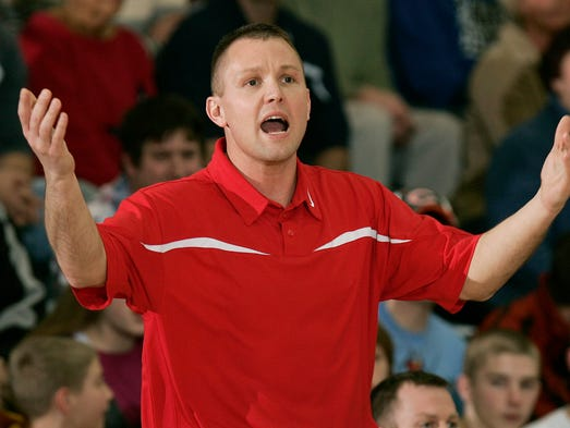 BNL head coach, and former Indiana Mr. Basketball Damon Bailey calls a play from the sidelines. The Franklin Central boys basketball team hosted Bedford North Lawrence Friday night, Feb 23, 2007.