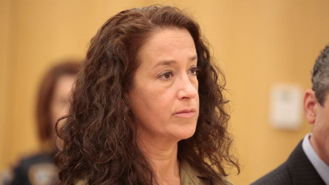 Emily Dearden, the NYPD  psychologist who is accused of trying to kill her husband in their Yonkers home in November of 2013, made a court appearance at Westchester County Courthouse on May 14, 2015.