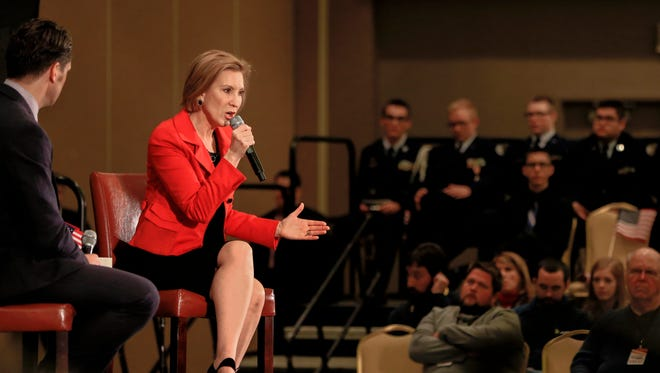 Republican presidential candidate Carly Fiorina sits on stage with Pete Hegseth, CEO of Concerned Veterans of America and Fox News contributor, as she speaks at a campaign stop in Council Bluffs, Iowa, Friday, Nov. 13, 2015. (AP Photo/Nati Harnik)