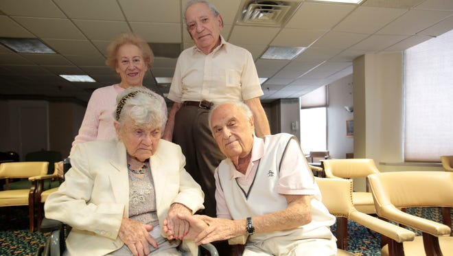 Shirley Queen, 89, and her husband Leonard, 91, rear, and Jaye Gillet, 89, and her husband Harold, 90, front. They are all residents at the Esplanade in White Plains.