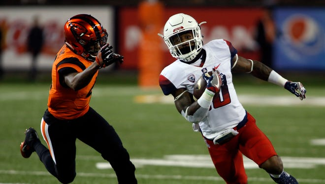 Arizona running back Samajie Grant, right, gets around Oregon State's Dwayne Williams during the first half of an NCAA college football game in Corvallis, Ore., Saturday Nov. 19, 2016.