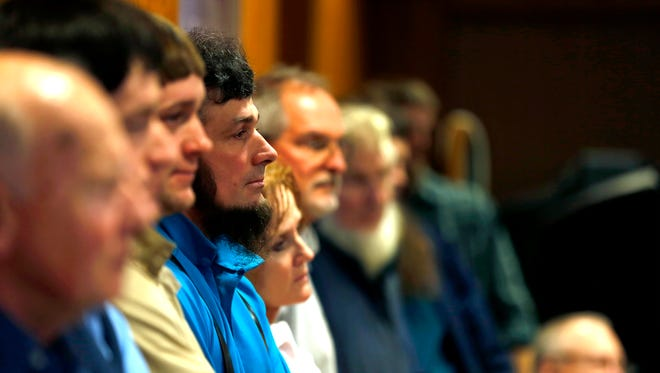 Members of the Amish community listen to people speak in opposition to a proposal to regulate safety features, insurance and license requirements on horse-drawn buggies at a Wood County Board of Supervisors meeting in Wisconsin Rapids, Wis., on Tuesday, December 19, 2017.