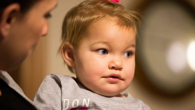 Melanie Kretschmer holds her daughter Naomi in their home in Marshfield, Wis., Monday, December 18, 2017.