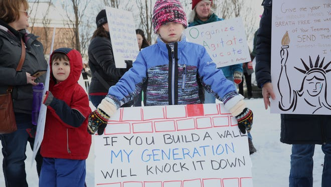 Madison Friedlander, 7, of Rochester, with her sign at the Women March in Seneca Falls.