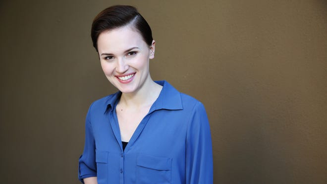 """Veronica Roth, author of the book, """"Divergent,"""" poses for a portrait in Beverly Hills, California on March 8, 2014. Multimillion-selling young adult author Roth is backing a holiday season campaign that supports First Book, which has distributed millions of works to children in need over the years. In a fundraising effort announced Monday, Dec. 1, 2014, for every $2.50 given to First Book, publisher HarperCollins will donate a copy of Roth's """"Divergent."""""""