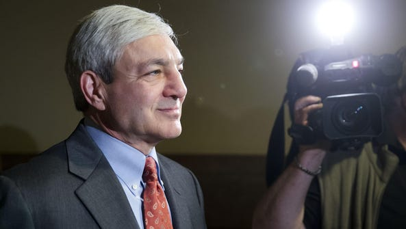 Former Penn State President Graham Spanier walks from