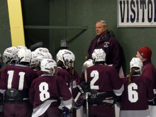 Scarsdale hockey coach Jim Mancuso gives last-minute instructions to his team before a regional win at Shenendehowa in March 2014. Mancuso is one of four Scarsdale coaches who won't return to the Raiders' athletic program in the 2016-17 school year.