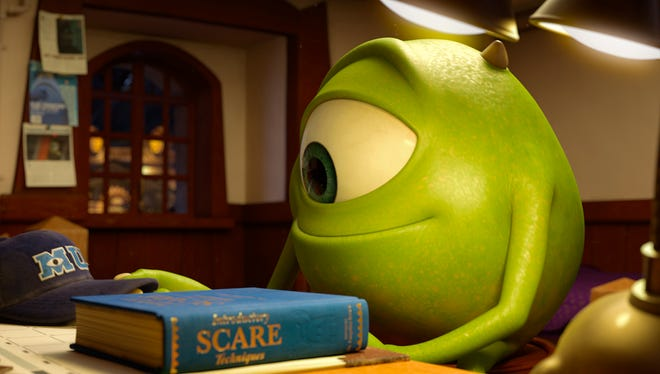 """Mike Wazowski (voiced by Billy Crystal) hits the books in """"Monsters University."""""""