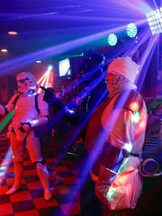 "A Stormtrooper, Darth Vader and Dengar the bounty hunter walk into a bar -- Wilminhton's Oddity Bar -- for a ""Star Wars""-themed bingo night Wednesday."