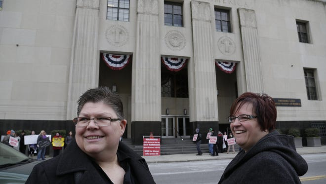 Plaintiffs Jayne Rowse, left, and her partner April DeBoer stand outside the federal courthouse in Detroit Feb. 25, 2014, taking a lunch break during their trial to fight the state's ban on gay marriage.