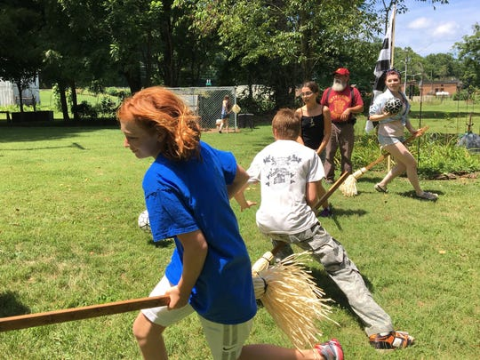 On Sunday, Aug. 13, 2017 at Mia and Chris Pugh's home in Churchville, players from the four houses of Hogwarts practice quidditch in preparation for Staunton, Virginia's Queen City Potter Party Sept. 22-24. Game 1 will open the Hogwarts Homecoming Quidditch Games when houses Hufflepuff and Ravenclaw enter the stadium in downtown Staunton 6 p.m. Friday, Sept. 22. Game 2 will follow at 7 p.m. with Gryffindor vs. Slytherin. Winners of games 1 and 2 duke it out at 8 p.m. to determine who will be victorious. Pictured left to right: Julia Miller – Gryffindor; Cody Madison – Slytherin; Karmen Warren – Ravenclaw; Chris Pugh – Godric Gryffindor; Briana Clements – Ravenclaw. The Pughs, of Medieval Fantasies Company, organize the Hogwarts Homecoming Quidditch Games and return as The Founders of Hogwarts. During the games, Chris, Godric Gryffindor, will act as head referee and Mia, Helga Hufflepuff, will be score keeper. Founders Rowena Ravenclaw and Salazar Slytherin, Dianna and Dan Pittman, will also assist in the games.