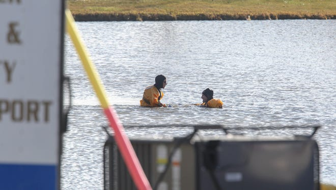 Ambulance and emergency response officials from Polk County search a pond and surrounding areas near Woodward for missing 17-year-old Sam Kemp Jr., who has been missing since Dec. 13.