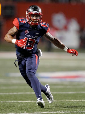 Fresno State free safety Derron Smith (13) looks to make a tackle against the San Diego State Aztecs.