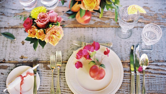 This photo provided by courtesy of Martha Stewart Living Omnimedia:  Flowers can have a less formal presentation, and seating can be more casual. (AP Photo/Martha Stewart Living Omnimedia, Inc.)