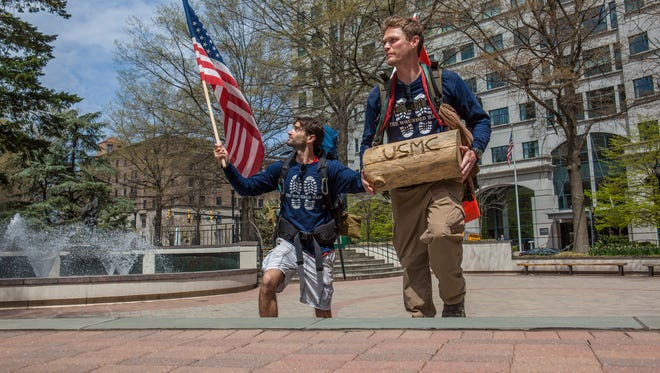 Two ex-Marines, Ross Delafield (right) and Joshua Perry, are walking from New York City to Washington, D.C., to raise awareness about military veteran suicides.