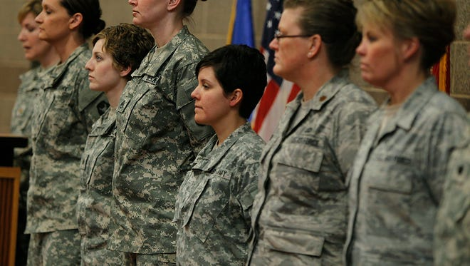 From left, Army Sgt. 1st Class Katie Reed, Army Sgt. Cassie Mecuk, Army Staff Sgt. Andrea Drost, Army Sgt. Katie Warden, Air Force Maj. Ann Todd, and Air Force Master Sgt. Holly Caroon