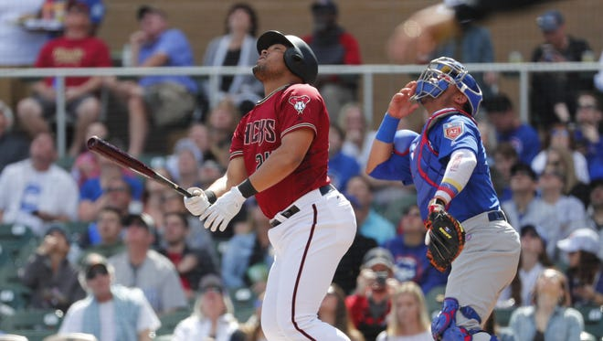 Arizona Diamondbacks left fielder Yasmany Tomas (24) pops up against the Chicago Cubs during a spring training game at Salt River Fields at Talking Stick March 4, 2018.