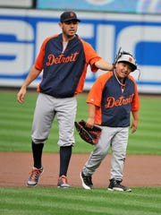 Tigers second baseman Ian Kinsler jokes around with Victor Martinez's son, Victor Jose, during and ALDS practice in Baltimore in 2014.