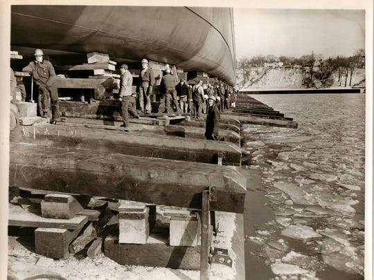 Work crews and photographers prepare for the launch