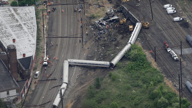 In an aerial photo, emergency personnel work at the scene of a deadly train wreck Wednesday in Philadelphia.